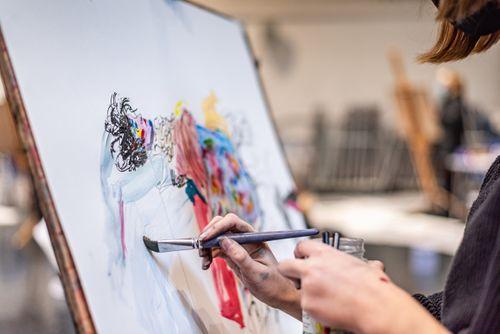 Student painting in studio