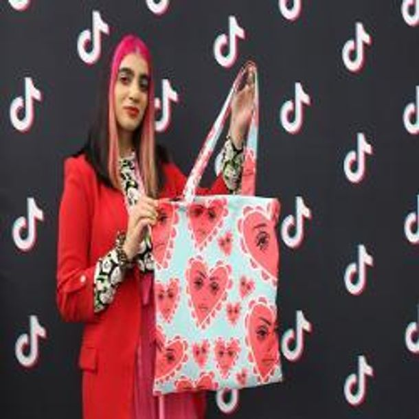 Hally Ahmed with her final print and tote bag