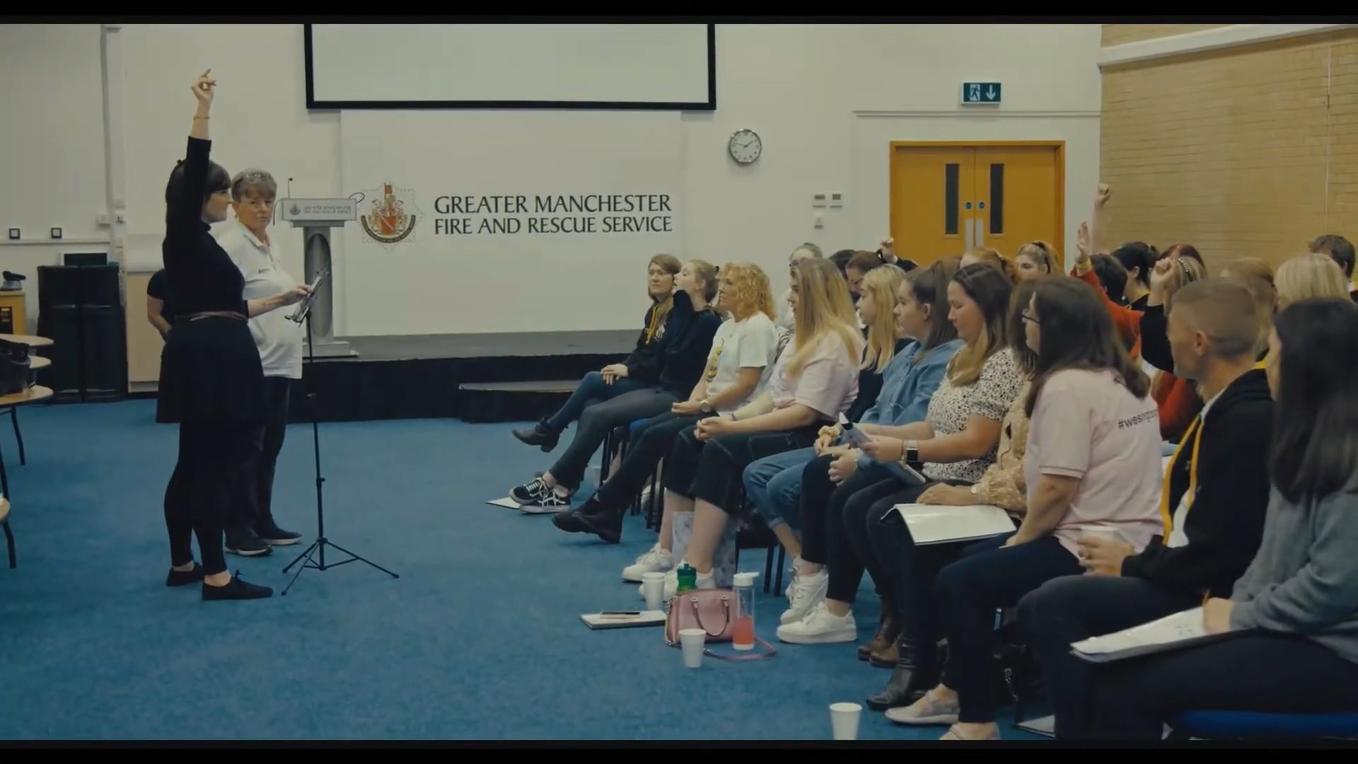 A choir practicing - a scene from A Manchester Story