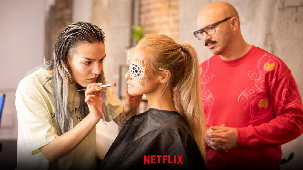 Hannah Cunningham applies her artistic flair to a model during Glow Up! (Picture courtesy of Netflix)